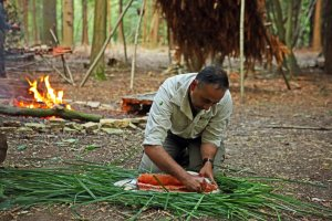 Manse panassing Salmon at Primitive Camp.jpg