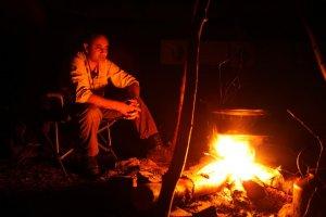 Manse sat around fire at night.jpg